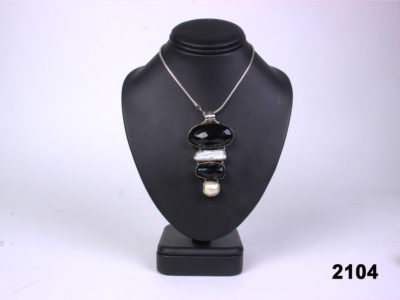 Front view of 925 Sterling silver jet and fresh water pearl pendant on 925 silver snake chain from Antiques of Kingston.