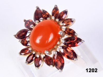 Front view of Modern Garnet and Carnelian 925 sterling silver ring in a floral sunshine design from Antiques of Kingston. SIze 6½ / N.
