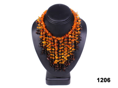 Front view of Real Baltic amber cascading necklace with cherry, honey and cognac amber pieces from Antiques of Kingston.