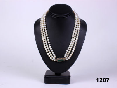 Art Deco real pearl necklace with 935 silver clasp adorned with green glass stone from Antiques of Kingston