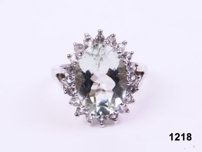 925 Sterling silver ring with a large oval cut pale blue topaz encircled by cubic zirconia from Antiques of Kingston