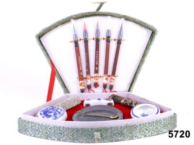 Oriental calligraphy set comprising of a variety of brushes, ink blocks and pots from Antiques of Kingston