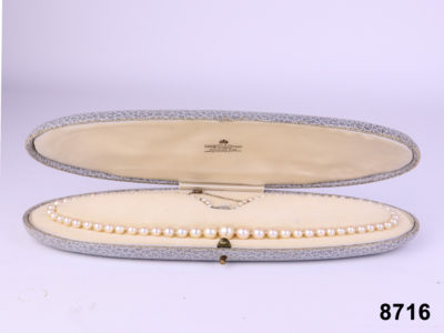 Pearl necklace with diamond clasp and safety chain from Garrard & Co Ltd 1951 from Antiques of Kingston