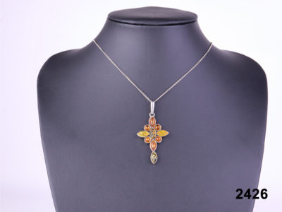Front view of 925 sterling silver hallmarked 3 tone amber cross pendant on a sterling silver chain from Antiques of Kingston