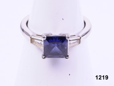 925 Sterling silver ring with square cut blue crystal and clear paste on shoulders from Antiques of Kingston