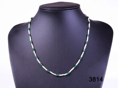 Natural pearl necklace with emeralds and 18 carat gold clasp from Antiques of Kingston