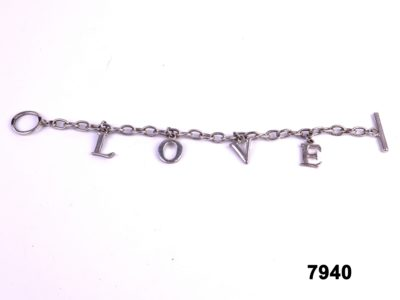 White metal bracelet with letters spelling LOVE from antiques of kingston