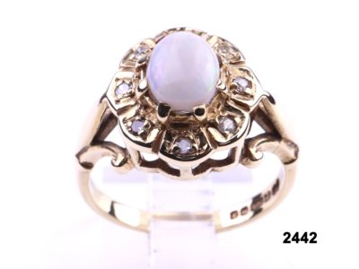 9 carat Gold ring set with 2 carat opal surrounded by diamonds from Antiques of Kingston