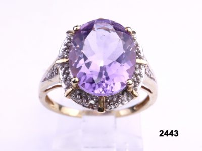 9 carat gold ring with oval cut lilac amethyst and diamonds from Antiques of Kingston
