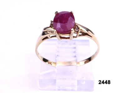 9 carat Gold ring set with oval cut ruby and a diamond on each shoulder from Antiques of Kingston
