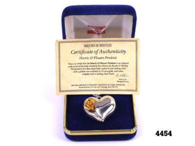 Silver heart pendant with gilt rose on chain Main photo showing necklace in box with certificate