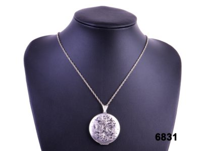Front view of Birmingham assayed sterling silver round locket with top opening on silver chain by L & W from Antiques of Kingston.