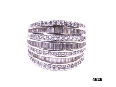 925 Sterling silver ring with alternating layers of round and baguette cut cubic zirconia stones Front view