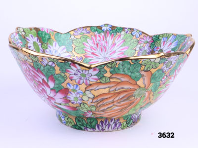 Colourful hand-painted Chinese bowl with chrysanthemums and fluted gilt edge Measures 95mm in diameter at base and 210mm across top Main side view