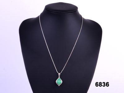 Front view of Reversible green and lilac jade pendant on a sterling silver snake chain from Antiques of Kingston