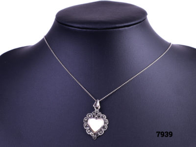 925 Sterling silver necklace with a sterling silver marcasite and white shell heart pendant Main front view image of necklace with pendant