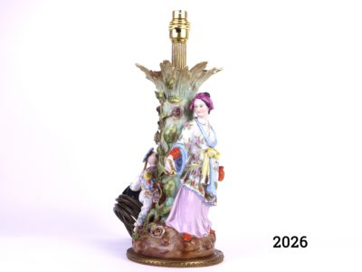 Antique continental porcelain lamp decorated with a woman and child in oriental dress playing around a tree (Some damage as shown - missing leaf) Measures 140mm in diameter at base Main photo showing taller figure