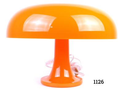 Iconic bright orange Nessino lamp designed by Italian designer Ginacarlo Mattioli for Artemide Measures 125mm in diameter at base and 320mm across the top Fully PAT tested Main photo showing whole mushroom shaped lamp from the side