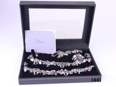 Christian Dior 3 piece set of chrome hearts jewellery consisting of ; Necklace with amethyst heart beads Adjustable from 365mm to 425mm and weighing 29g Bracelet with rose quartz heart beads adjustable from 160mm to 200mm Ring with flourite heart beads Size O / 7.25 and weighing 9.3g All with crystal studded Dior lettering Each piece with matching colour crystals on the lettering Main photo of all three pieces displayed in the box with instructions for care pamphlet