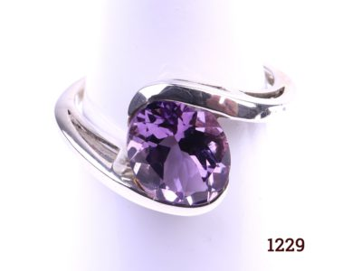 925 Sterling silver ring in the modernist style with oval cut amethyst Size P / 7.5 Main photo showing the front of ring displayed on stand