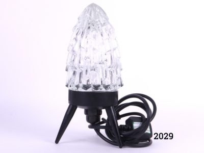 1960s Rocket shaped lamp with three legged black plastic base and a glass shade Measures 125mm in circumference at base Main photo showing whole lamp