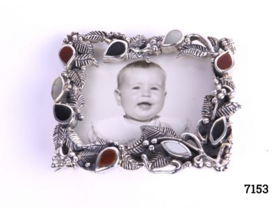 925 Sterling silver picture frame brooch with vine like frame decorated with leaves including onyx, carnelian and Mother Of Pearl (Can be worn as a brooch or pin doubles as a stand to display as a small picture frame) Main photo showing the front of brooch