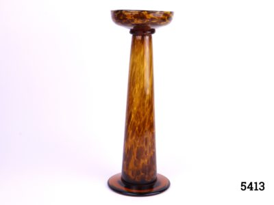 Art Deco amber glass stand. Tall weighted glass stand in amber coloured glass (Possibly for hat display) Measures 120mm in diameter at base and 118mm in diameter at top Main photo showing front view of glass stand
