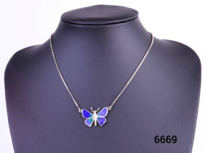 Blue enamelled silver butterfly pendant on sterling silver box chain Box included Pendant measures 30mm wide by 20mm long Photo of necklace displayed on stand