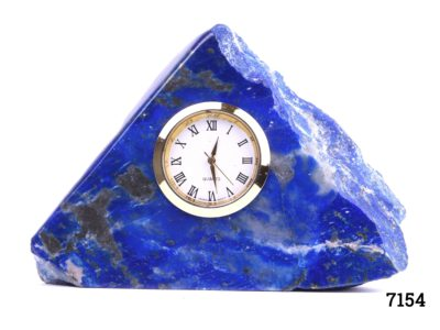 Lapis lazuli desk clock Modern battery operated clock set into a substantial piece of natural lapis lazuli stone In full working order Clock measures 35mm in diameter Main photo of the front of clock