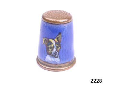 Vintage copper thimble with hand-painted Jack Russell terrier on blue enamel Opening measures 17mm in diameter Main photo showing side view of thimble with portrait of Jack Russell