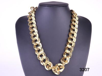 Vintage heavy Monet necklace in gilt metal chain c1980s costume jewellery statement piece Signed Monet Adjustable from 495mm to 525mm Main photo showing necklace displayed on stand front a front view