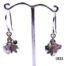 Azuni sterling silver earrings decorated with charms consisting of pearlised heart, silver leaf and crystal beads in different colours. Main photo of earrings displayed on a stand