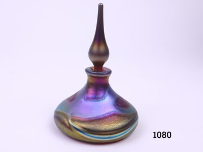 Okra Studio Art Glass scent bottle in shades of iridescent blue, purple and gold Signed to the base Measures 75mm in diameter at base Main photo of bottle with stopper on