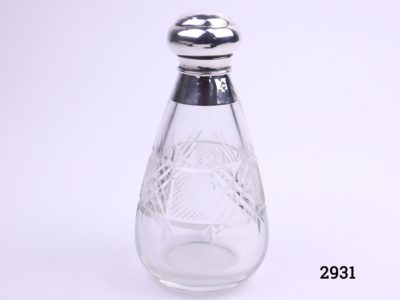 Silver topped scent bottle pear shaped cut glass bottle with screw top and inner glass stopper. c1930 London assayed Made by Henry Perkins & Sons Measures 65mm in diameter at base Main photo of complete bottle