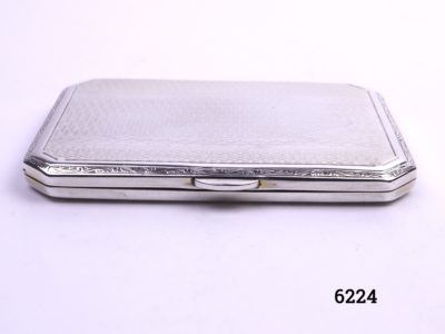 Small silver cigarette case with engine turned design on both sides Made by Turner & Simpson of Birmingham c1930/31 Main photo of case from the front on a flat surface