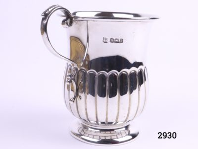 Small sterling silver mug with gilt interior c1920 Sheffield assayed made by James Deakin and Sons Measures 52mm in diameter at base and 70mm across the top Main photo showing mug with handle to the left and hallmark visible just to the right of handle
