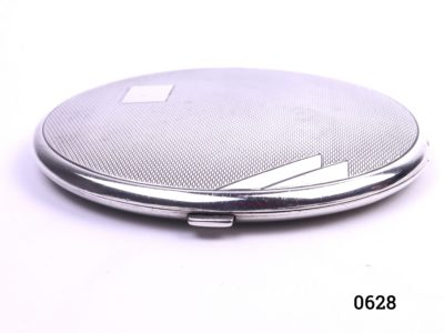 Sterling silver Art Deco compact with vacant cartouche for personalisation c1934 Birmingham assayed by Beddoes & Co Measures 90mm in diameter Main photo looking at compact on a flat surface from the front by opening tab