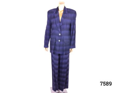 1990s striped trouser suit in navy. Size 10-12. Elastic and drawstring waisted trousers with pockets and jacket with fake pockets. Made by Sticky Fingers Main photo showing suit displayed on mannequin from a front view