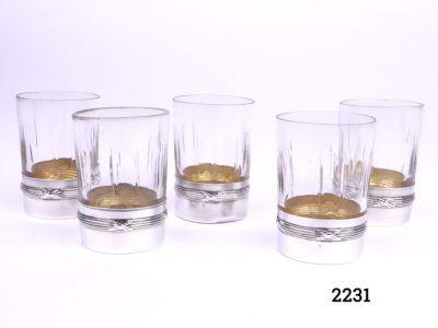 Set of 5 antique crystal shot glasses with silver bases with a gilt interior French silver hallmark Minerva c1915 Each glass measures 50mm tall and 36mm in diameter Main photo of all 5 shot glasses