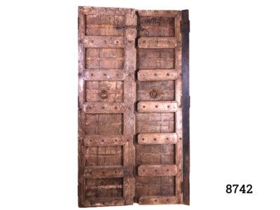 Antique Asian door c1780-1820 from India/Tibet. Centre opening hinged double door panels with metal door pulls/handles. Main photo showing both door panels in a closed position