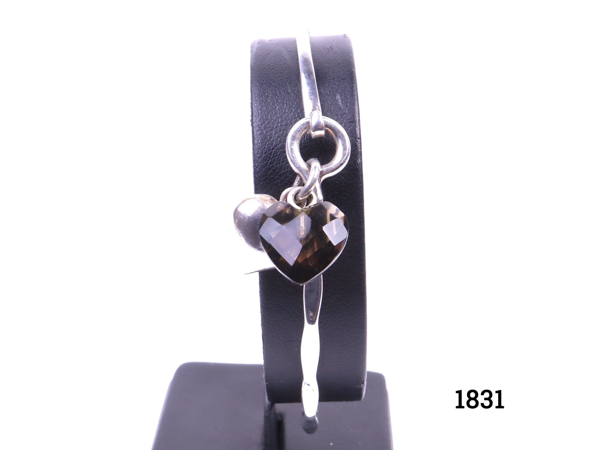 Azuni sterling silver bangle with 2 silver and glass heart shaped charms with clip fastening Full London assayed hallmarked c2006 Inner length 70mm width 55mm Main photo showing front of bangle with charms to the front