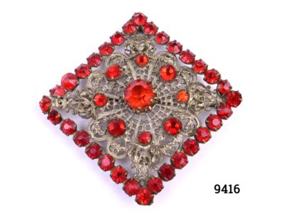 Bohemian costume jewellery brooch. Vintage Czechoslovakian square brooch in gilt metal set with red glass stones Main photo showing front of brooch with vibrant red stones on ornate gilt metal