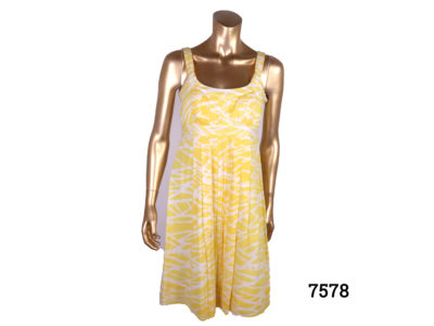 Calvin Klein strap dress in yellow and white cotton. Side zip fastening. Size 10 Main photo front view of dress on mannequin