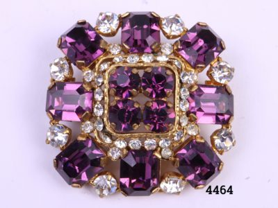 Costume jewellery vintage brooch with amethyst coloured and clear glass stones Measures 40mm square Close up photo of brooch front