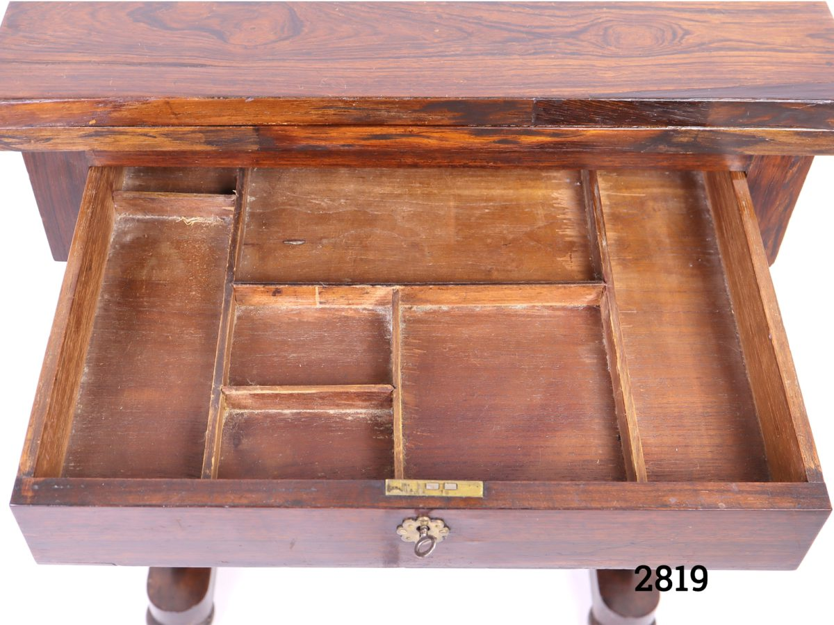 Antique gaming table. Swivel top opens to reveal green felted card playing surface to one side and chess, draughts and cribbage surface on other. Drawer for games pieces below table as well as basket drawer for larger gaming pieces (No games pieces included) Measurements when open Length 765mm Width 510mm Photo of top drawer open