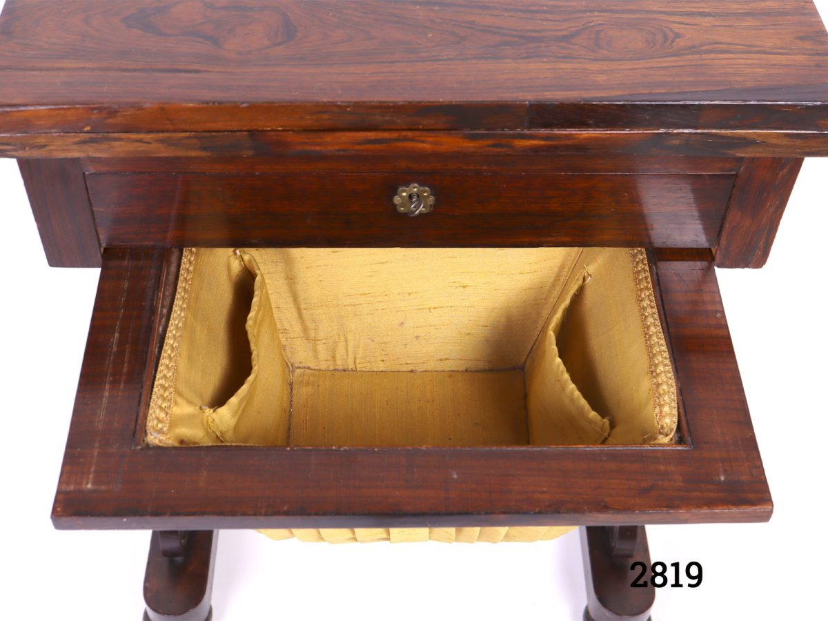Antique gaming table. Swivel top opens to reveal green felted card playing surface to one side and chess, draughts and cribbage surface on other. Drawer for games pieces below table as well as basket drawer for larger gaming pieces (No games pieces included) Measurements when open Length 765mm Width 510mm Photo of open basket drawer