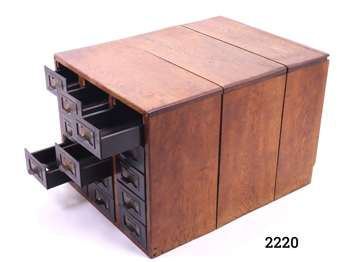 Vintage wooden index card cabinet with 15 metal drawers Each drawer measures 540mm long by 100mm wide and 65mm deep Photo of slight side angle with some of the metal drawers open