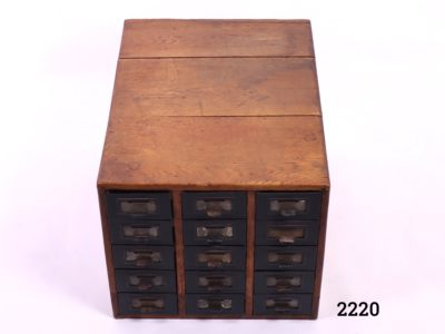 Vintage wooden index card cabinet with 15 metal drawers Each drawer measures 540mm long by 100mm wide and 65mm deep Main photo of cabinet from a front slightly raised angle