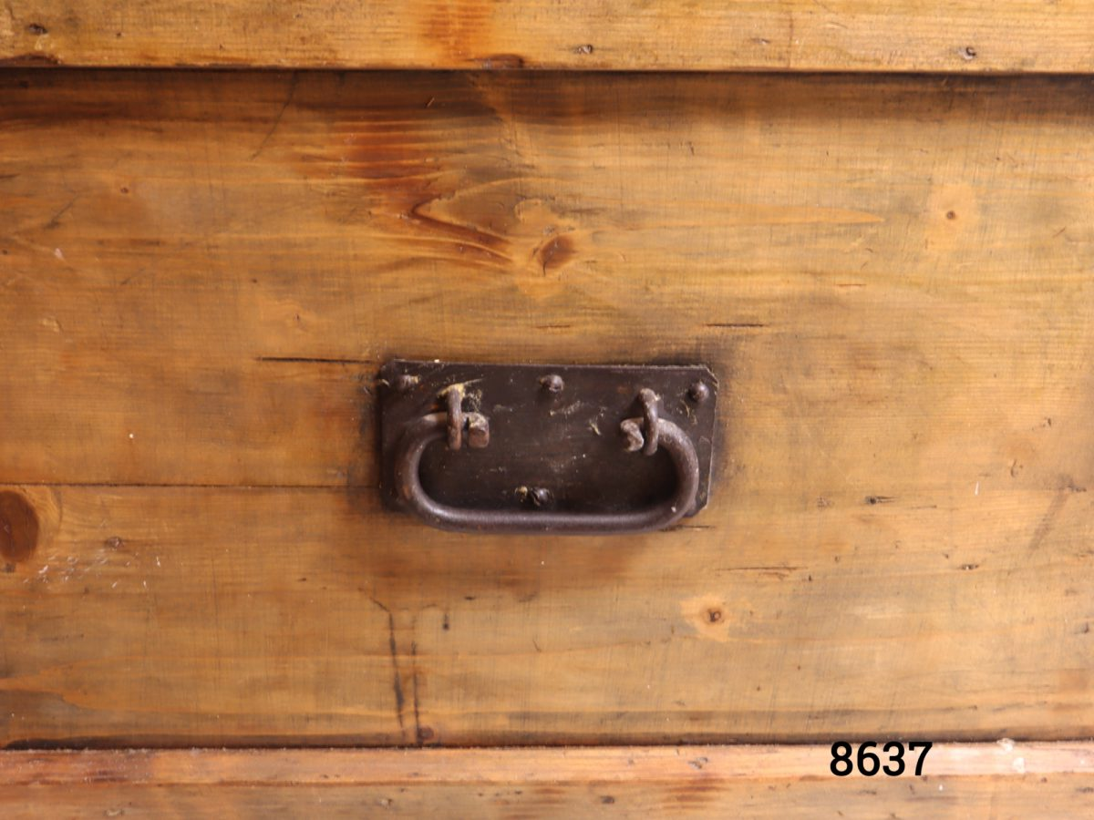 Large vintage pine blanket box with metal drop handles Lock with no key Close up photo of one of the metal drop handles