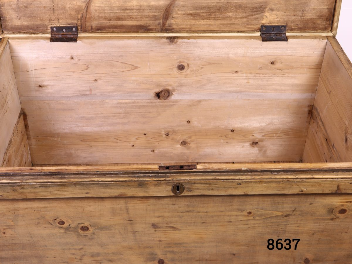 Large vintage pine blanket box with metal drop handles Lock with no key close up photo of front of box with lid open showing partial interior